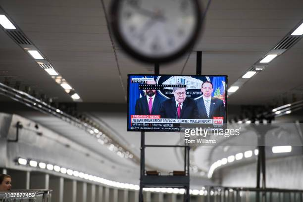 Attorney General William Barr appears on a television in the Capitol subway to Rayburn building while conducting a news conference at the Justice...