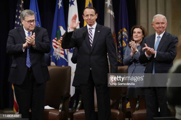 S Attorney General William Barr Assistant Attorney General Beth Williams and former US Attorney General Jeff Sessions applaud for Deputy Attorney...