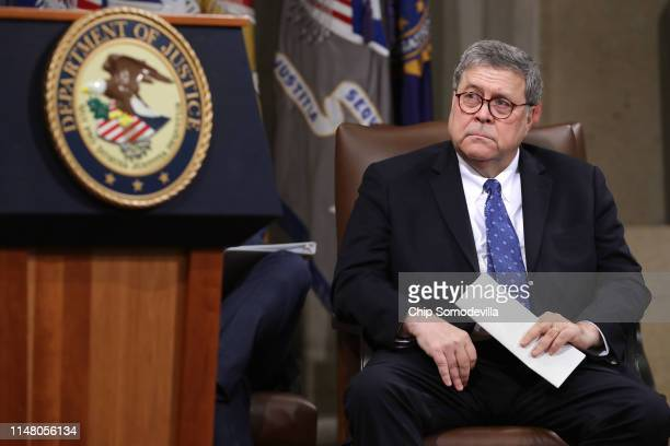 S Attorney General William Barr attends a farewell ceremony for Deputy Attorney General Rod Rosenstein at the Robert F Kennedy Main Justice Building...