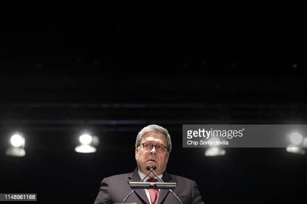 S Attorney General William Barr delivers remarks during the National Police Week 31st Annual Candlelight Vigil on the National Mall May 13 2019 in...