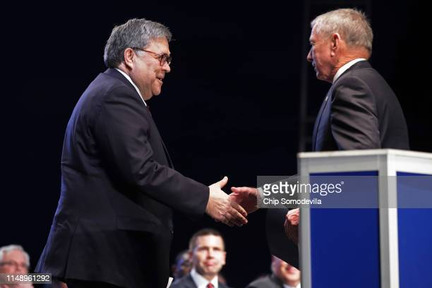 S Attorney General William Barr is welcomed to the lectern by former Attorney General John Ashcroft during the National Police Week 31st Annual...