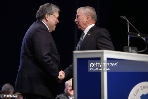 Attorney General William Barr is welcomed to the lectern by former Attorney General John Ashcroft during the National Police Week 31st Annual...