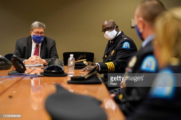 S Attorney General William Barr left is introduced to members of the St Louis Police Department by police chief John Hayden second from left during a...