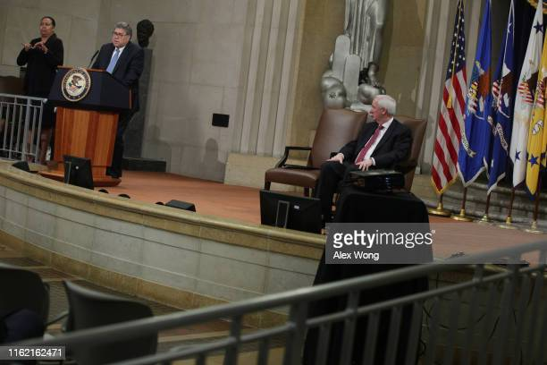 S Attorney General William Barr speaks as Deputy Attorney General Jeffrey Rosen listens during a Combating AntiSemitism Summit at the Justice...