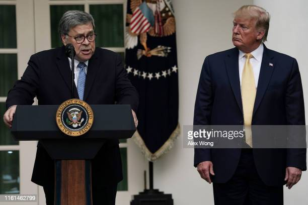 S Attorney General William Barr speaks as President Donald Trump looks on during a Rose Garden statement on the census July 11 2019 at the White...