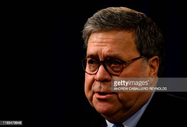 US Attorney General William Barr speaks at a press conference regarding the December 2019 shooting at the Pensacola Naval air station in Florida at...