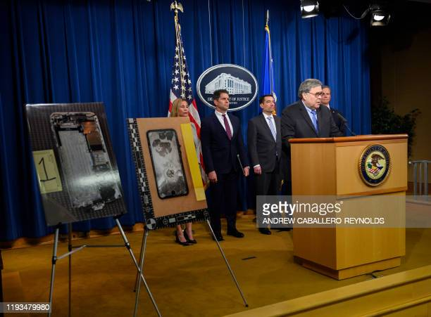 US Attorney General William Barr speaks next to diplayed pictures of the shooter's cellphone at a press conference regarding the December 2019...