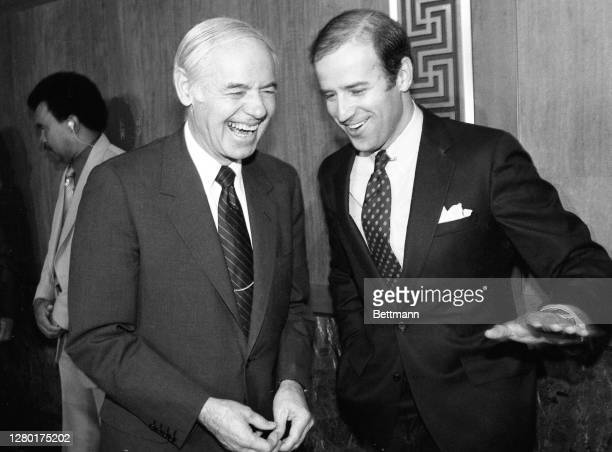 Attorney General William French Smith and Senator Joseph Biden, share a joke shortly before a hearing where Smith outlined the administration's...