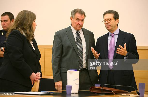Attorney Ginnine Fried her client L Lindley DeVecchio and attorney Douglas Grover talk during DeVecchio's murder trial in state Supreme Court October...