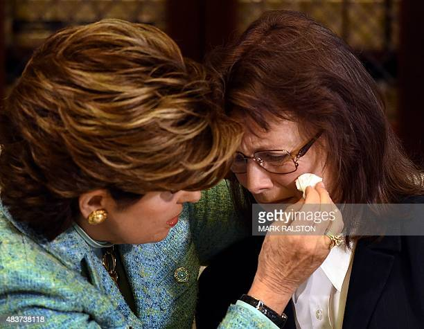 Attorney Gloria Allred consoles Linda Ridgeway Whitedeer who is one of three new alleged sexual assault victims of comedian Bill Cosby during a news...