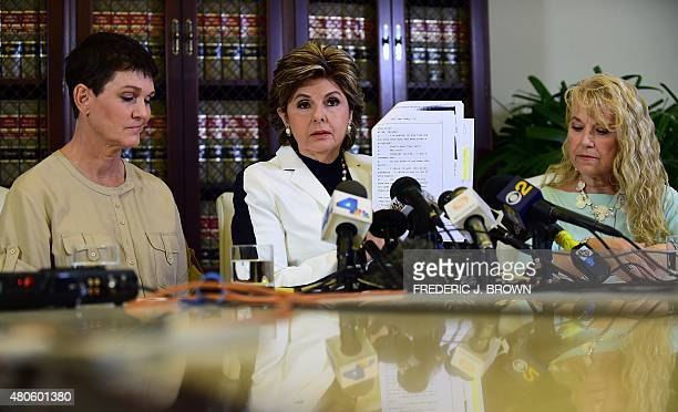 Attorney Gloria Allred displays a copy of excerpts released from Bill Cosby's deposition in the Constand lawsuit on July 13 2015 in Los Angeles...