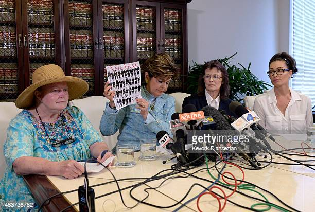 Attorney Gloria Allred holds a copy of a recent New Yorker magazine showing alleged sexual assault victims of comedian Bill Cosby on the cover as she...