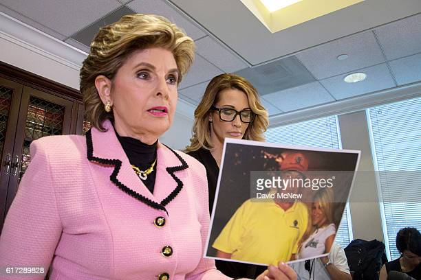 Attorney Gloria Allred holds a photo of jessica drake with Donald Trump, taken in 2006 during an event where Drake alleges now-Republican...