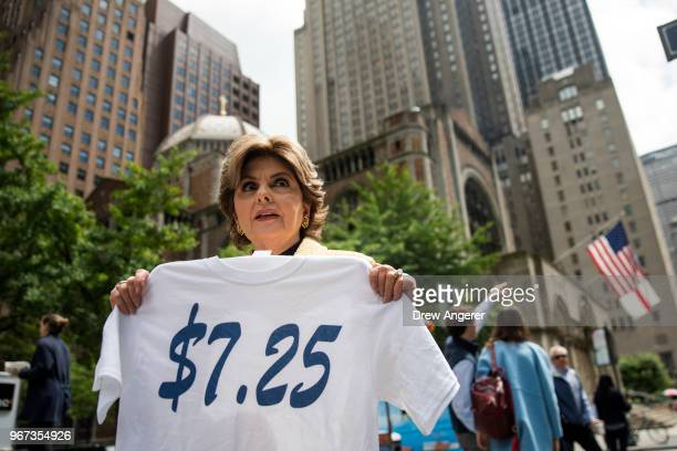 Attorney Gloria Allred holds a t-shirt that reads '$7.25' as she arrives for a press conference about the low pay and treatment of former Houston...
