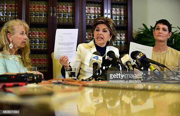 Attorney Gloria Allred holds copies of statements by both Beth Ferrier and Rebecca Lynn Neal on July 13 2015 in Los Angeles California where the two...