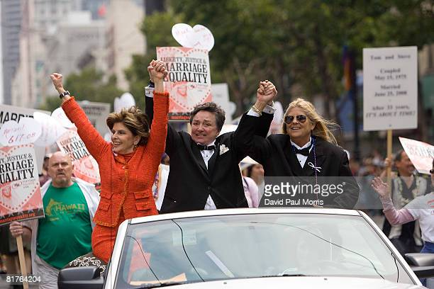 Attorney Gloria Allred holds hands with a lesbian couple, spouses Robin Tyler and Diane Olson as they take part in the 38th Annual San Francisco...