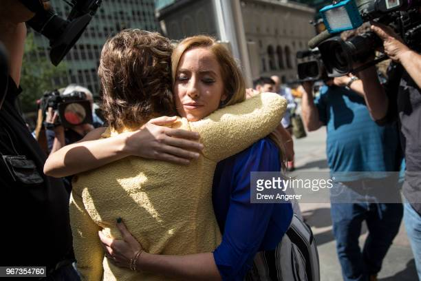 Attorney Gloria Allred hugs former Houston Texans cheerleader Ainsley Parish after a press conference about the low pay and treatment of former...