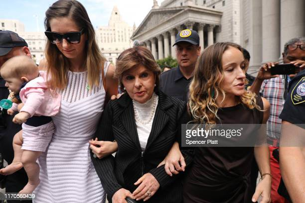 Attorney Gloria Allred leaves a New York court house with two women a woman who did not wish to be identified and Teala Davies who have publicly...