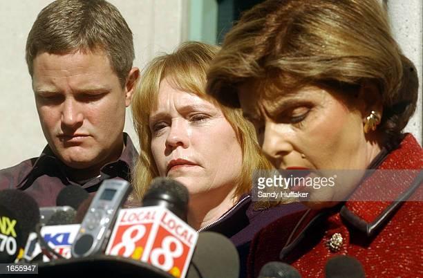 Attorney Gloria Allred right speaks to the news media as Brenda and Damon van Dam the parents of Danielle van Dam a sevenyearold child murdered...