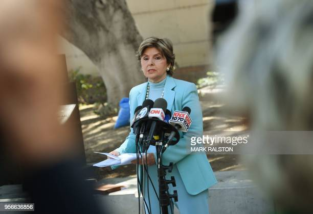 Attorney Gloria Allred speaks to the media outside Los Angeles County Superior Court in Los Angeles California on May 9 2018 after filing a lawsuit...