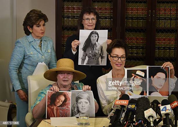 Attorney Gloria Allred watches as three alleged sexual assault victims of comedian Bill Cosby Colleen Hughes Linda Ridgeway Whitedeer and actress...