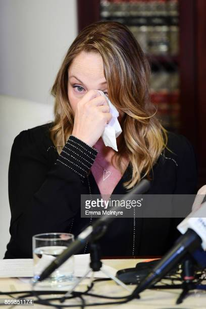 Attorney Gloria Allred's client Louisette Geiss speaks during a press conference about her allegations of sexual harassment by Harvey Weinstein at...