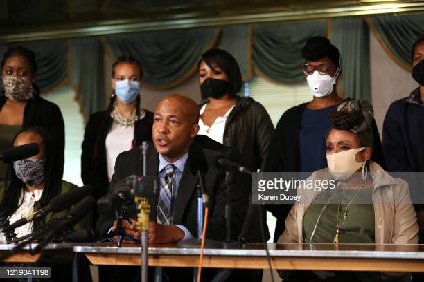Attorney James Bible speaks to the media flanked by the family of Manuel Ellis and members of the Tacoma Action Collective during a press conference...