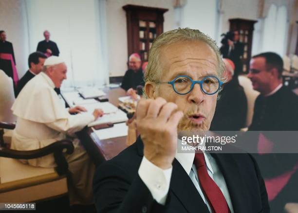 Attorney Jeff Anderson gestures in front of a photo of US bishops meeting the Pope during a news conference to announce the filing of a federal...