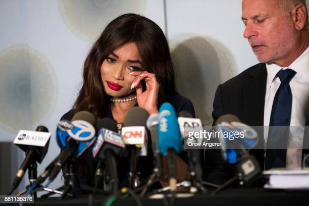 Attorney Jeff Herman looks on as actress Kadian Noble wipes away tears as she discusses her experiences with Harvey Weinstein during a press...