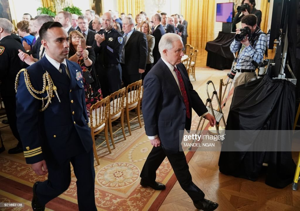 US Attorney Jeff Sessions walks from the East Room after attending the Public Safety Medal of Valor Awards Ceremony at the White House on February 20, 2018 in Washington, DC. /