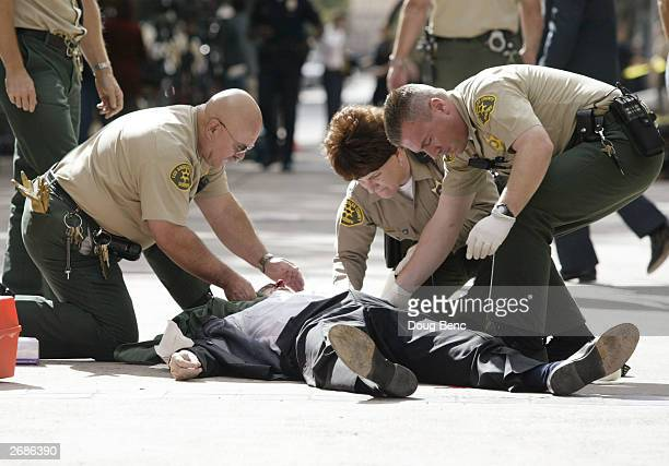 Attorney Jerry Curry is treated by Los Angeles County deputies after being shot outside the Los Angeles County Court House on October 31 2003 in Van...