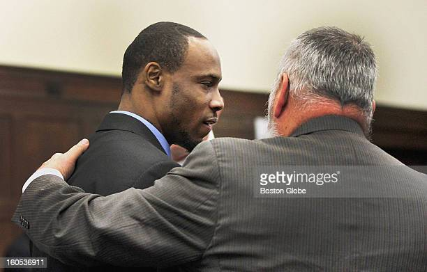 Attorney John Amabile prepared to hug defendant Dwayne Moore following the conclusion of the Mattapan massacre murder trial at Boston's Suffolk...