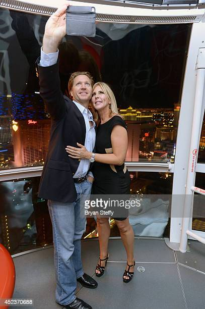 Attorney John J. Pankauski and television personality Vicki Gunvalson take a selfie as they ride the world's tallest observation wheel, The High...