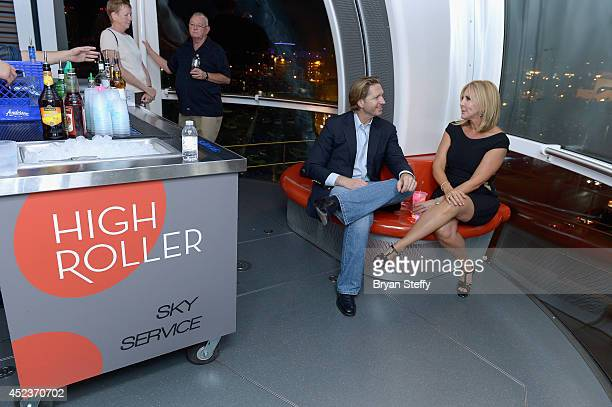 Attorney John J. Pankauski and television personality Vicki Gunvalson ride the world's tallest observation wheel, The High Roller at The LINQ on July...