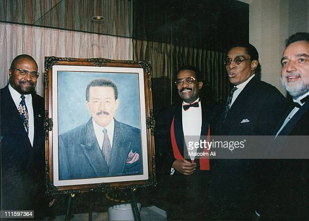 Attorney Johnnie Cochran is honored by the Brotherhood Crusade at their annual banquet Flanking a portrait of Cochran is Mohammad Mubarak Johnnie...