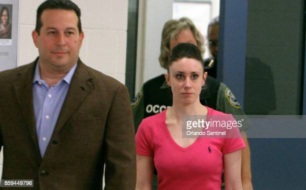 Attorney Jose Baez escorts Casey Anthony as she leaves the Orange County Corrections Facility on July 17 in Orlando, Fla.