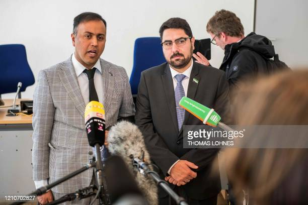 Attorney KhubaibAli and coplaintiff Mohamad Alshaar answer journalists' questions outside the courtroom during a break in a trial against two Syrian...