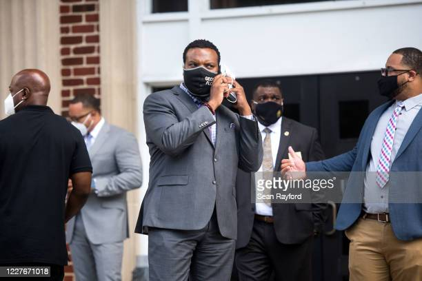Attorney Lee Merritt representing the family of Ahmaud Arbery talks on the phone outside the Glynn County Courthouse on July 17 2020 in Brunswick...
