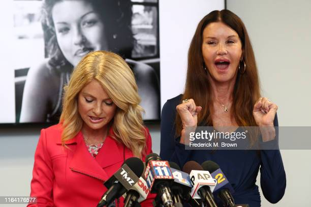 Attorney Lisa Bloom and Janice Dickinson speak during a press conference to announce a settlement in their defamation lawsuit against Bill Cosby at...