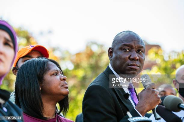 Attorney Lonita Baker watches as attorney Ben Crump speaks during a press conference at Jefferson Square Park on September 25, 2020 in Louisville,...