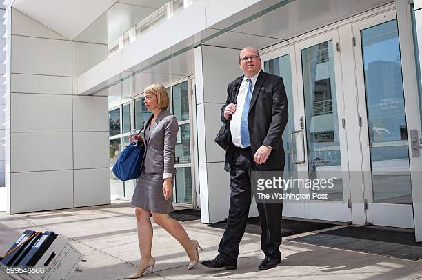 Attorney Marc Elias exits Sandra Day O'Connor United States Courthouse in Phoenix, AZ, with attorney Amanda Callais on Wednesday, Aug. 3 after the...