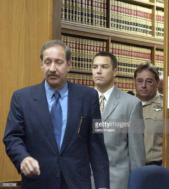 Attorney Mark Geragos leads the way as Scott Peterson enters Stanislaus Superior Court May 27 2003 in Modesto California Peterson is charged with...