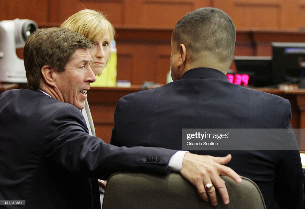 Attorney Mark O'Mara, left, talks to George Zimmerman during a hearing for Zimmerman at the Seminole County Courthouse in Sanford, Florida, on Friday, October 19, 2012.