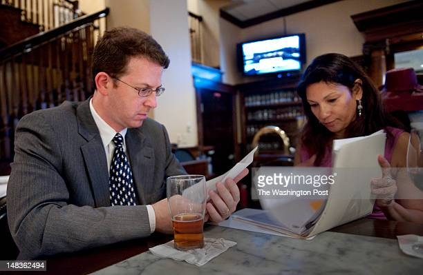 Attorney Mark S Zaid and his client Sabrina De Sousa peruse documents with at a local restaurant in Tysons Corner Virginia on Friday June 27 2012 De...