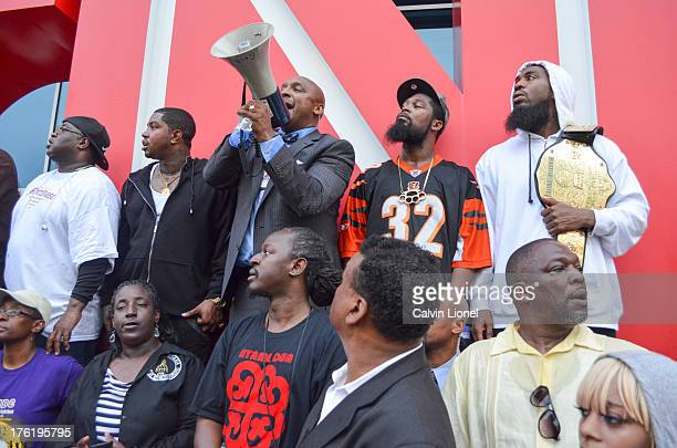 Attorney Mawuli Mel Davis, rappers Pastor Troy and Lil Scrappy address a crowd of demonstrators outside of the CNN Center in downtown Atlanta,...