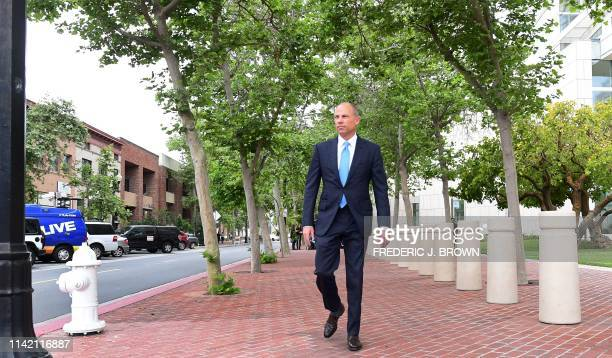 Attorney Michael Avenatti makes his way to an awaiting vehicle after addressing the media outside the Santa Ana federal courthouse in Santa Ana...