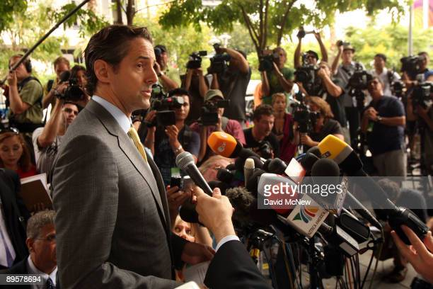 Attorney of Debbie Rowe, Eric George speaks to the press outside of Los Angeles Superior Court following a hearing to finalize an agreement for...