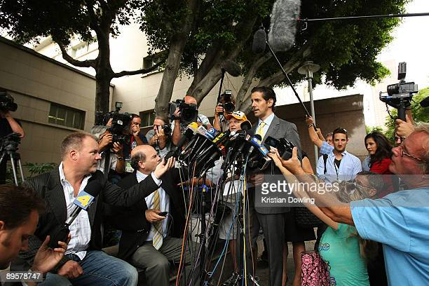 Attorney of Debbie Rowe Eric George speaks to the press outside of Los Angeles Superior Court following a hearing to finalize an agreement for...