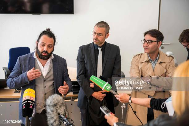 Attorney Patrick Kroker and coplaintiffs Wassim Mukdad and Hussein Ghrer answer journalists' questions outside the courtroom during a break in a...