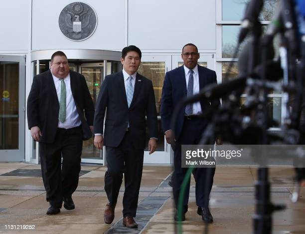 S Attorney Robert Hur FBI Special Agent Gordon Johnson and Art Walker of the Coast Guard Investigative Service walk up to speak to the media about...